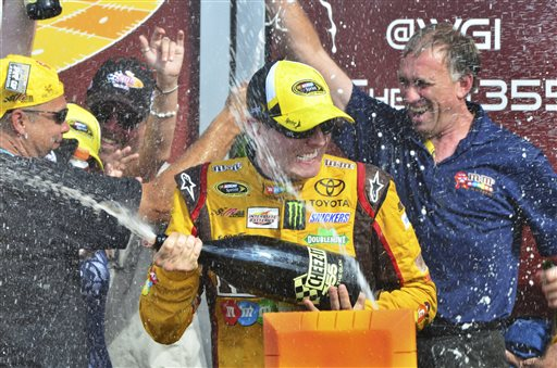 Driver Kyle Busch celebrates in Victory Lane after winning at The Glen on Sunday in Watkins Glen, N.Y.