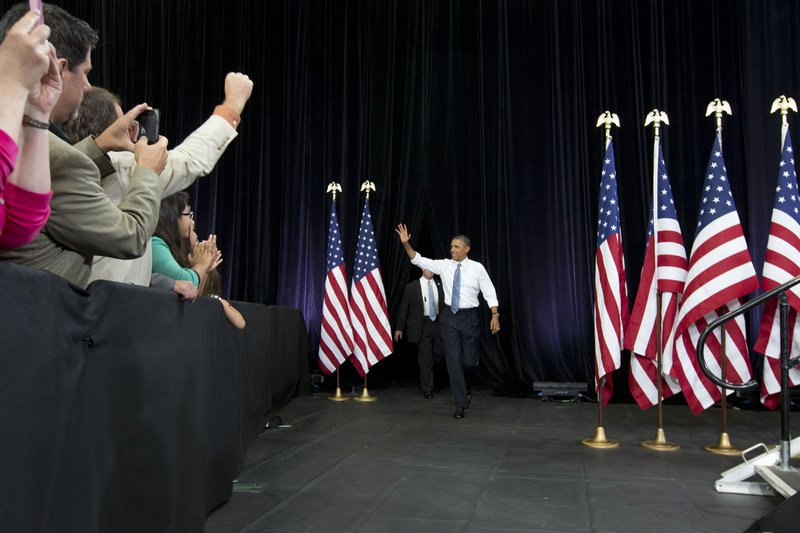 "President Barack Obama waves to the crowd as he arrives to speak about housing Tuesday at Desert Vista High School in Phoenix. Afterward, the president headed to Los Angeles to appear on ""The Tonight Show with Jay Leno."""