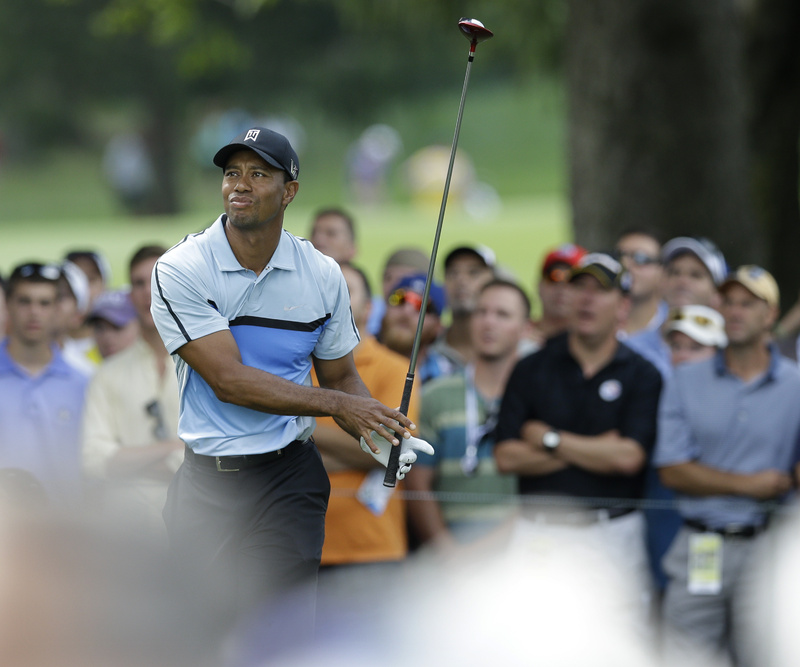 Tiger Woods watches his tee shot on the 18th hole during the first round of the PGA Championship golf tournament at Oak Hill Country Club, Thursday in Pittsford, N.Y.