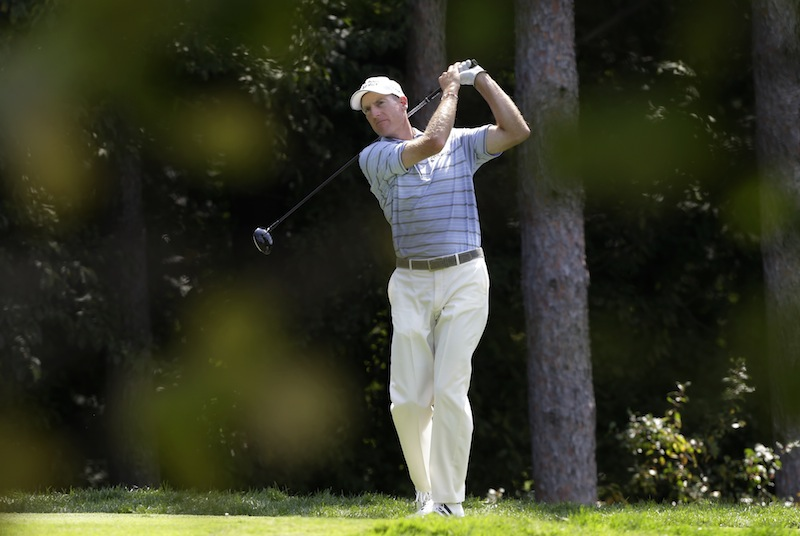 Jim Furyk watches his tee shot on the fourth hole during the first round of the PGA Championship golf tournament at Oak Hill Country Club, Thursday, Aug. 8, 2013, in Pittsford, N.Y. (AP Photo/Charlie Neibergall)