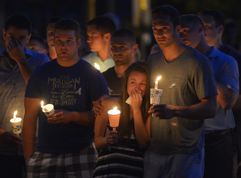 Friends and residents of Wilbraham, Mass., gather at Gazebo Park for a candlelight vigil for Amy Lord on July 24. Lord, a native of Wilbraham, was found stabbed to death at Hyde Park's Stony Brook Reservation last month.