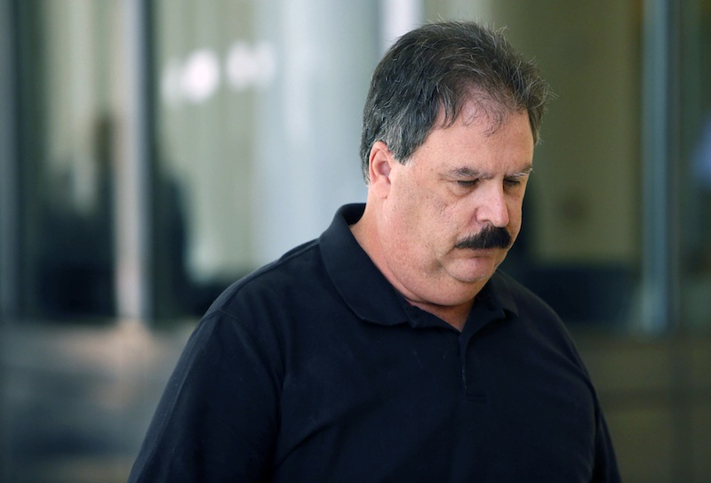 Former City of Buffalo parking meter mechanic James Bagarozzo leaves federal court in Buffalo, N.Y. after he was handed a 2 1/2 year prison term for stealing $210,000 in quarters from the meters he was supposed to be repairing over an eight year period, Friday, Aug. 16, 2013 in Buffalo, N.Y. (AP Photo/The Buffalo News, Derek Gee)
