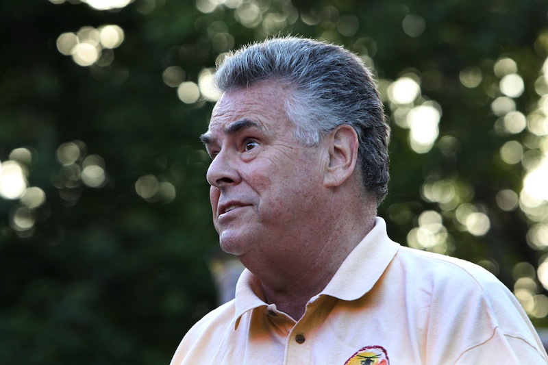 U.S. Rep. Pete King, R-N.Y. speaks at an outdoor barbecue at the home of Don Rowan, Sunday, Aug. 4, 2013 in Wakefield, N.H. King is considering running for president in 2016.(AP Photo/Jim Cole)