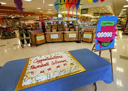 A cake celebrating a Powerball winner sits on a table near the entrance of Stop & Shop in South Brunswick, N.J., on Thursday. One of the three winning Powerball tickets was sold at this store.
