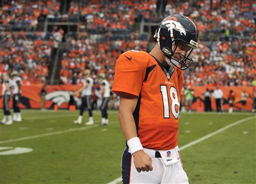 Though his team is struggling on and off the field, Denver Broncos quarterback Peyton Manning is still looking forward to the news season.