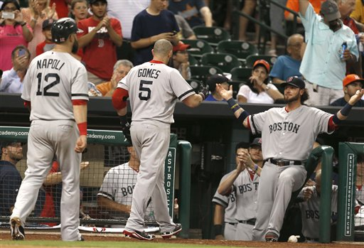 Boston Red Sox's Jarrod Saltalamacchia, right, welcomes Jonny Gomes (5) and Mike Napoli (12) back to the dugout after Gomes hit a three-run homer against the Houston Astros in the sixth inning of a baseball game Tuesday, Aug. 6, 2013, in Houston. (AP Photo/Pat Sullivan) Minute Maid Park