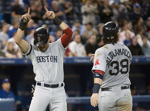 Boston Red Sox teammates Jacoby Ellsbury, left, and Jarrod Saltalamacchia celebrate after scoring the game runs to defeat the Toronto Blue Jays during the eleventh inning of a baseball game in Toronto on Tuesday, August 13, 2013. (AP Photo/The Canadian Press, Nathan Denette) Blue Jays;athlete;athletes;athletic;athletics;Canada;Canadian;Center;Centre;competative;compete;competing;competition;competitions;event;game;Jays;League;Major;MLB;pro;professional;Rogers;sport;sporting;sports;Toronto;baseball;American;AL;2013