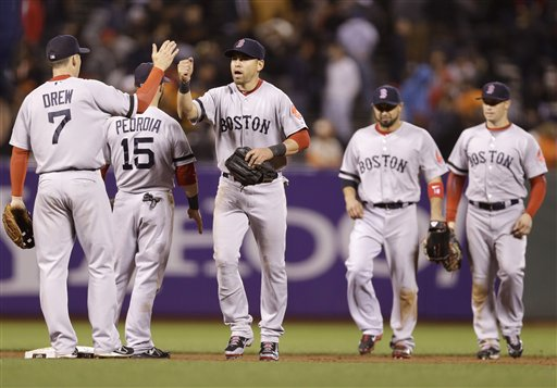 The Boston Red Sox celebrate a 7-0 win over the San Francisco Giants during a baseball game on Monday, Aug. 19, 2013, in San Francisco. (AP Photo/Marcio Jose Sanchez)