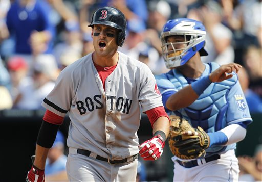 Boston Red Sox third baseman Will Middlebrooks, left, reacts after striking out in the ninth inning Sunday against the Kansas City Royals at Kauffman Stadium in Kansas City. The Royals defeated the Red Sox 4-3.