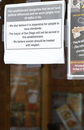 A sign posted on the outside of the entrance to a Hooters restaurant states that San Diego Mayor Bob Filner will not be served there.