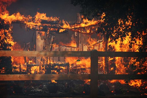 Multiple structures burn in the Poppet Flats area as the Silver Fire roared through the area along Highway 243 between Banning and Idyllwild, Calif. on Wednesday.