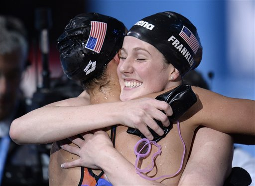 United States Women's 4x100m medley relay team members Missy Franklin, right, and Megan Romano embrace after winning the gold medal at the FINA Swimming World Championships in Barcelona on Sunday.