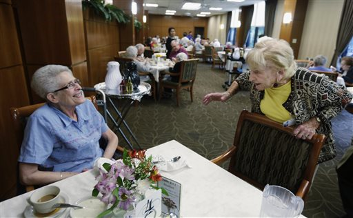 """Edith Stern, 92, talks to a new resident in the cafeteria at her retirement home in Chicago. Stern is a """"super ager"""" participating in a Northwestern University study of people in their 80s and 90s. Stern is a vibrant presence at the home, where she acts as a sort of room mother, volunteering in the gift shop, helping residents settle in and making sure their needs are met."""