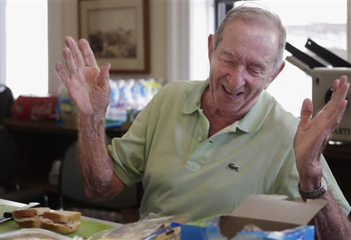 """85-year-old Don Tenbrunsel, a soup kitchen volunteer, laughs with other volunteers as he makes lunches at St. Josaph's Church in Chicago. Tenbrunsel is a """"super ager"""" participating in a Northwestern University study of people in their 80s and 90s with astounding memories."""