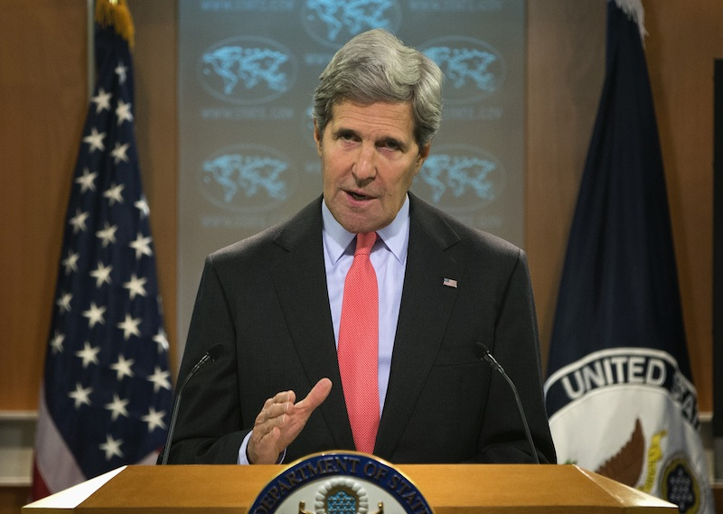 Secretary of State John Kerry gestures during a statement on the ongoing situation in Egypt before the start of a press briefing at the State Department in Washington, Wednesday, Aug. 14, 2013. Kerry said the violence in Egypt is deplorable and is a serious blow to reconciliation efforts. He says it runs counter to Egyptians' aspirations for peace. (AP Photo/Evan Vucci)