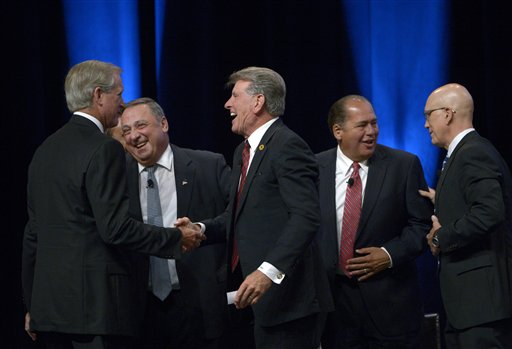 """Hampton Products International Chairman and CEO H. Kim Kelley, left, Maine Gov. Paul LePage, second from left, Idaho Gov. C.L. """"Butch"""" Otter, center, West Virginia Gov. Earl Ray Tomblin, second from right, and National Retail Federation President Matthew Shay shake hands after participating in a panel discussion at the Wal-Mart U.S. Manufacturing Summit in Orlando, Fla., Thursday."""