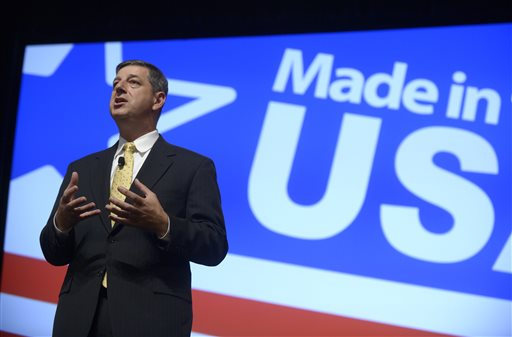 Wal-Mart U.S. President and CEO Bill Simon addresses attendees of the Wal-Mart U.S. Manufacturing Summit in Orlando, Fla., Thursday.