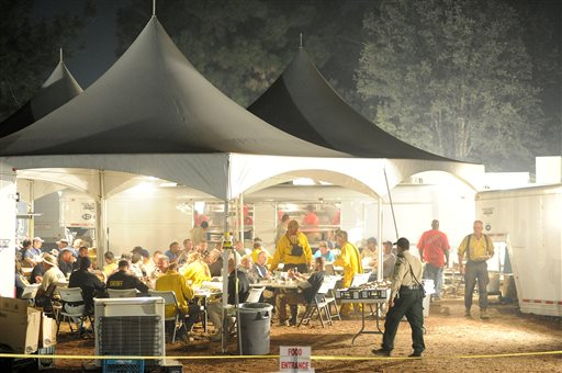 Firefighters are fed in tents set up at the Rim Fire incident command post 7 miles east of Groveland, after a hard day of fighting the fire.