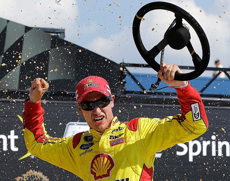 Joey Logano celebrates winning the NASCAR Sprint Cup series Pure Michigan 400 auto race at Michigan International Speedway in Brooklyn, Mich., on Sunday.