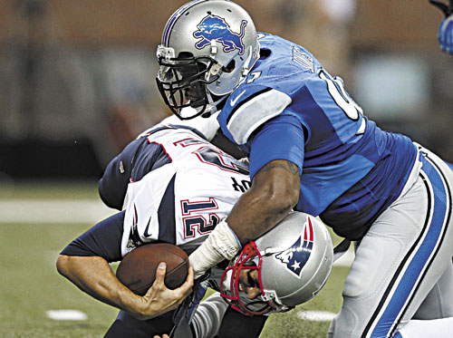 DOWN, BUT NOT OUT: New England Patriots quarterback Tom Brady (12) is sacked by Detroit Lions defensive end Jason Jones (91) in the second quarter of the Lions' 40-9 win in a preseason game Thursday in Detroit.