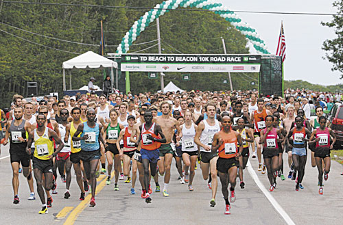 HERE WE GO: Runners, including eventual winner Micah Kogo (bib 3 in blue shirt, black shorts) of Kenya, leave the start line of the 16th annual TD Bank Beach To Beacon 10K road race Saturday in Cape Elizabeth.