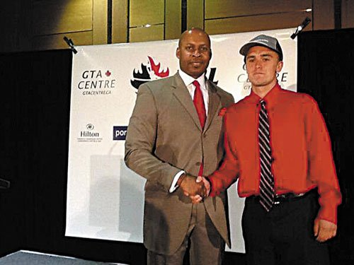 WELCOME ABOARD: Maranacook graduate Ryan Martin, right, was drafted by the Island Storm of the National Basketball League of Canada on Monday night. The Island Storm play on Prince Edward Island.