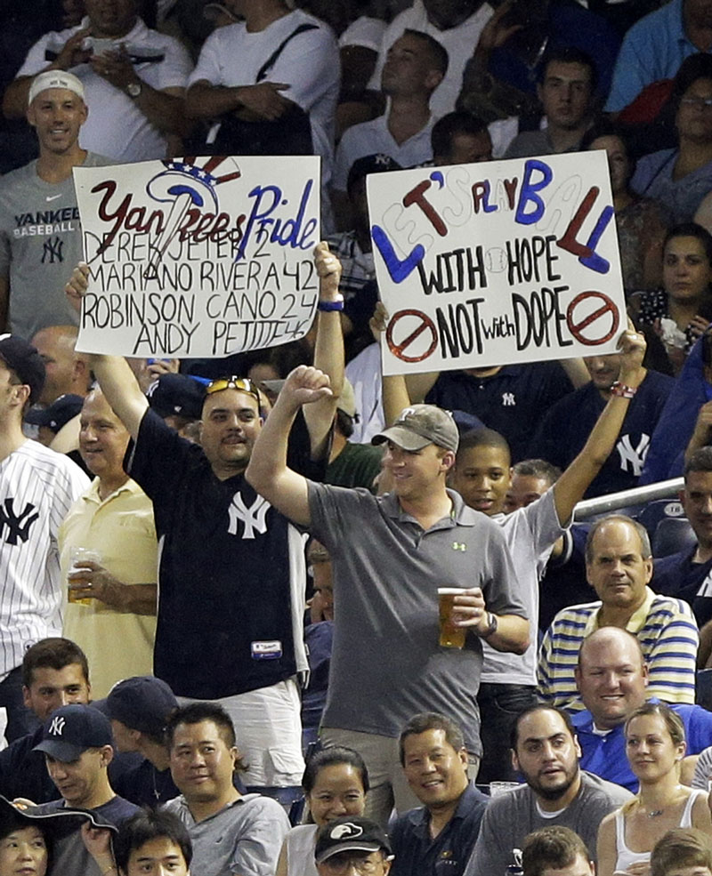 SHOWING THEIR FEELINGS: Fans hold up signs during Alex Rodriguez's first at-bat in the first inning of the Yankees' game against the Detroit Tigers on Friday in New York.
