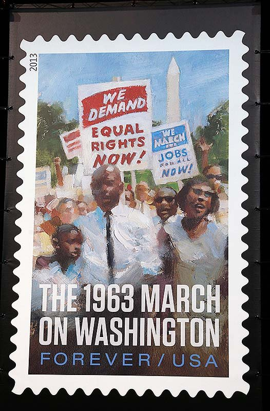 A photo of the limited edition U.S. Postal Service stamp commemorating the 50th anniversary of the March on Washington is seen after it was unveiled at an event at the Newseum in Washington on Friday.