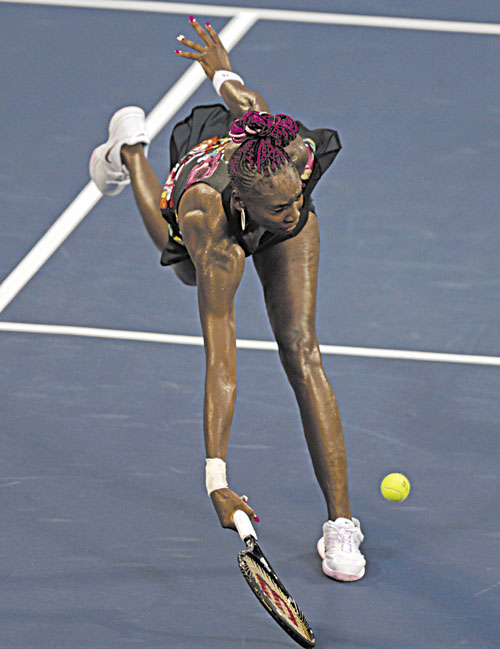 STRETCH: Venus Williams lunges for a shot against Jie Zheng during the second round of the U.S. Open on Wednesday in New York. Zheng won 6-3, 2-6, 7-6 (5).