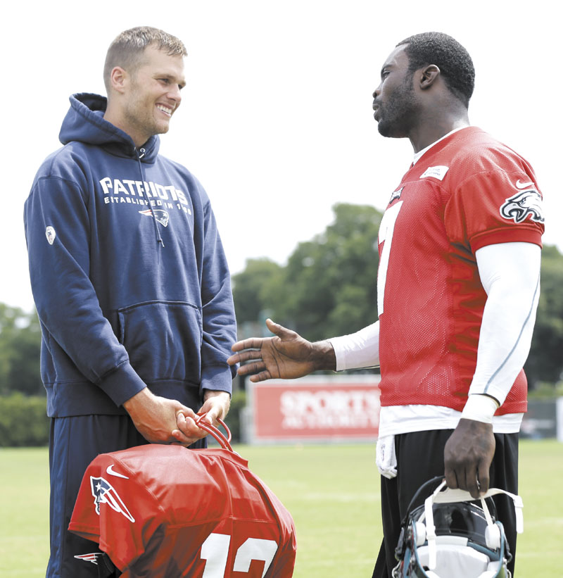 LET'S DO THIS: New England Patriots' quarterback Tom Brady, left, and Philadelphia Eagles' quarterback Michael Vick talk during a joint practice Thursday in Philadelphia. The Patriots and Eagles play their first preseason game tonight in Philadelphia.