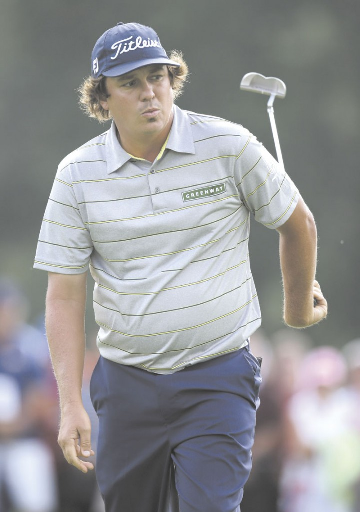 STELLAR DAY: Jason Dufner reacts after missing a birdie putt on the 17th hole during the second round of the PGA Championship on Friday at Oak Hill Country Club in Pittsford, N.Y. Dufner shot 63 in the second round and has a two-shot lead. AP photo