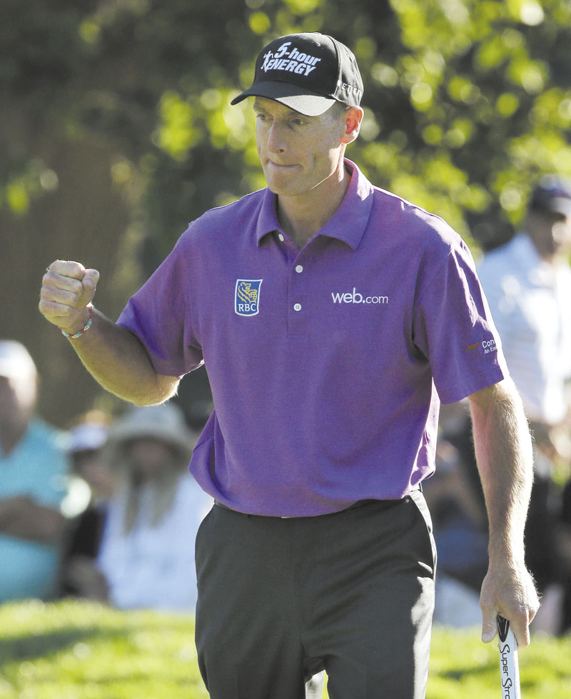 SOLID WORK: Jim Furyk celebrates after a birdie on the 17th hole during the third round of the PGA Championship on Saturday at Oak Hill Country Club, Saturday in Pittsford, N.Y. Furyk shot 68 in the third round and is 9-under for the tournament. He has a one-shot lead over Jason Dufner heading into today's final round
