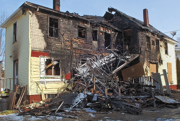 This file photo shows 146 Northern Ave. in Augusta, the morning after it was heavily damaged by a fire on March 21. The building has since been razed. Stephen Cormier, charged with two counts of arson related to the fire, is unfit to stand trial, a judge ruled today.