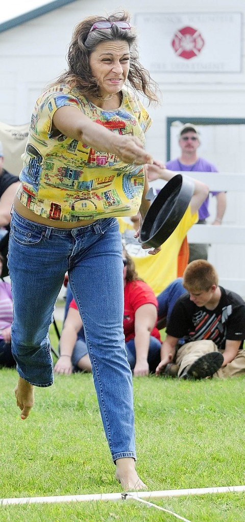 Jodi Lucas, 41, of Auburn, competes in the Ladies Fry Pan Throwing Contest today at the Windsor Fair.