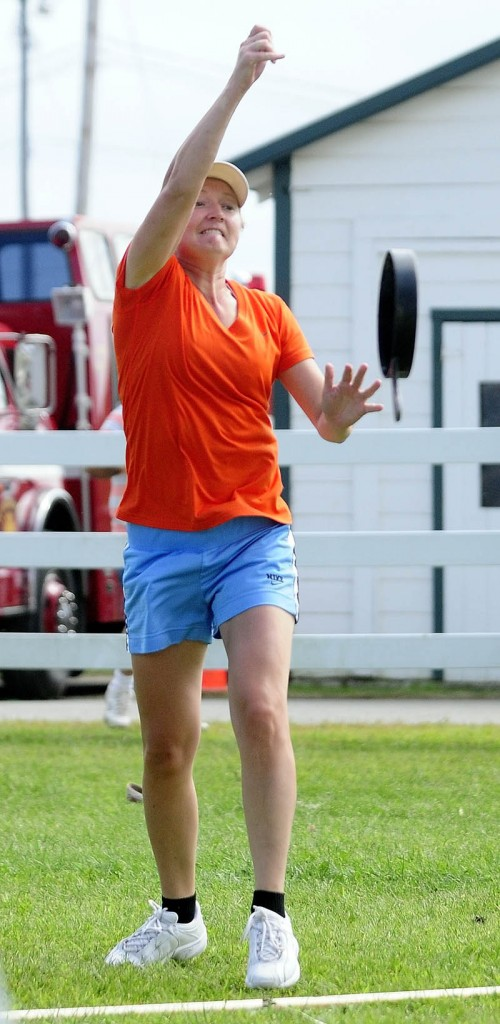 Ingrid Prikryl, 33, of Windsor, competes in the Ladies Fry Pan Throwing Contest today at the Windsor Fair. She won her age group and the overall grand championship by defeating other age-group winners.