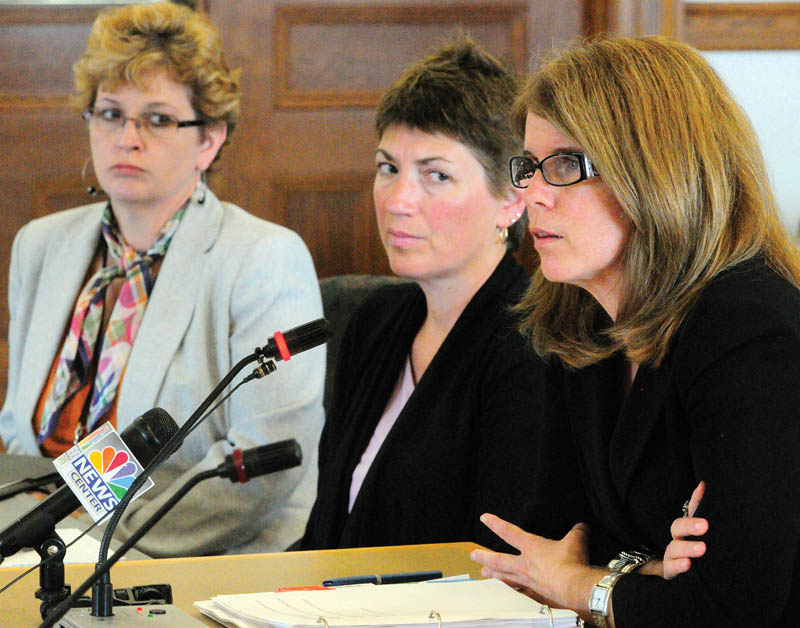 Jody Breton, Associate Commissioner, Department of Corrections, left, Mary Louise McEwen, Superintendent of Riverview Psychiatric Center, and Mary Mayhew, commissioner of the Department of Health and Human Services, testifies during a Appropriations Committee hearing on Thursday at the State House in Augusta.
