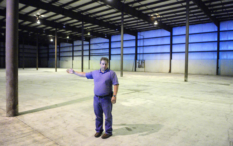 During a tour of proposed new facility, Don Hutchins, fleet manager for the Maine Department of Transportation, talks about plans for moving operations from Capital Street to 66 Industrial Drive in Augusta.