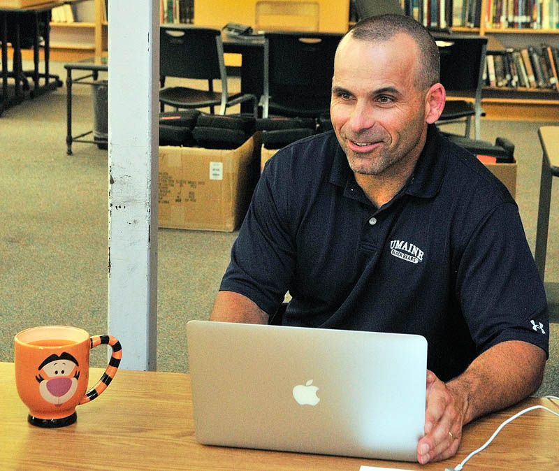 Gardiner Area High School Principal Chad Kempton works on his laptop in the library on Wednesday at Gardiner Area High School in Gardiner.
