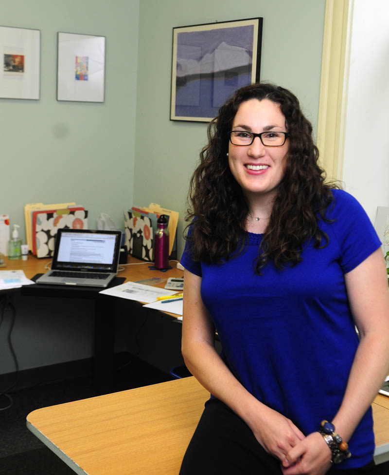 Katie Joseph, the new curriculum director for Regional School Unit 11, poses in her office today.