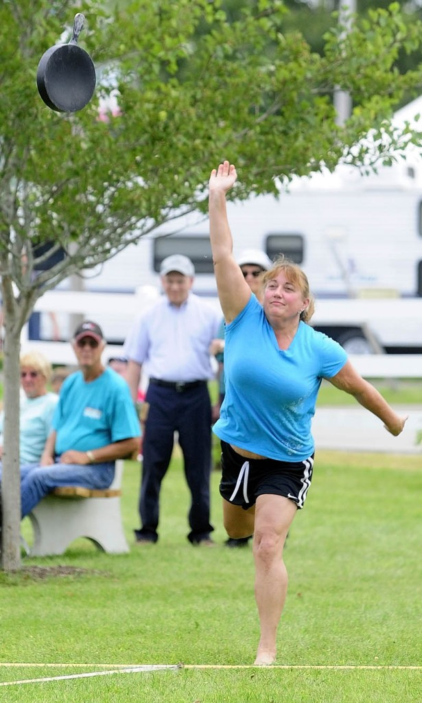 Lori Hawk, 52 of China, competes in the Ladies Fry Pan Throwing Contest today at the Windsor Fair. She took first in her age group.