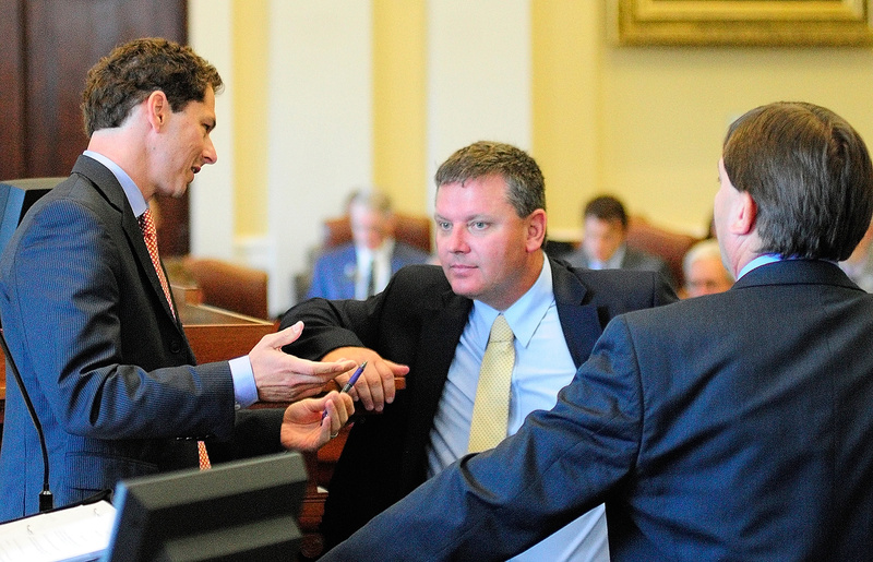 Senate President Justin Alfond, left, confers with Senate leaders Sen. Michael Thibodeau, R-Winterport, and Sen. Troy Jackson, D-Allagash, during a special session Thursday at the State House in Augusta.