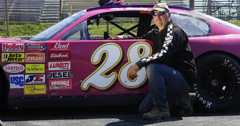 READY TO WIN: Ken Beasley of Richmond poses with his No. 28 Chevy Impala Pro Stock car Wednesday afternoon at Wiscasset Speedway. Beasley is looking for his first feature win in the division.
