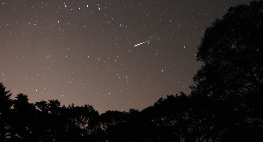 A meteor blazes across the northeast sky above Hallowell on Monday at the peak of the annual Perseid meteor shower. The annual August passage through the debris of the Swift-Tuttle comet exposes earth to hundreds of rocks burning up in the atmosphere. The spectacle reached its height during the early morning hours today, but occasional shooting stars will persist streaking from an area in the night sky close to the constellation Perseus for several weeks.