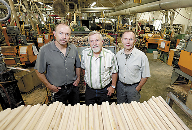 Owners and brothers Jody Fletcher, left, Doug Fletcher, center, and Gary Fletcher of Maine Wood Products inside company's New Vineyard mill.