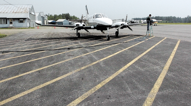 Pilot Phillip Bussiere of Skowhegan refuels at the Central Maine Regional Airport in Norridgewock. Police say someone is jamming radio transmissions near the airport, making operations there dangerous.