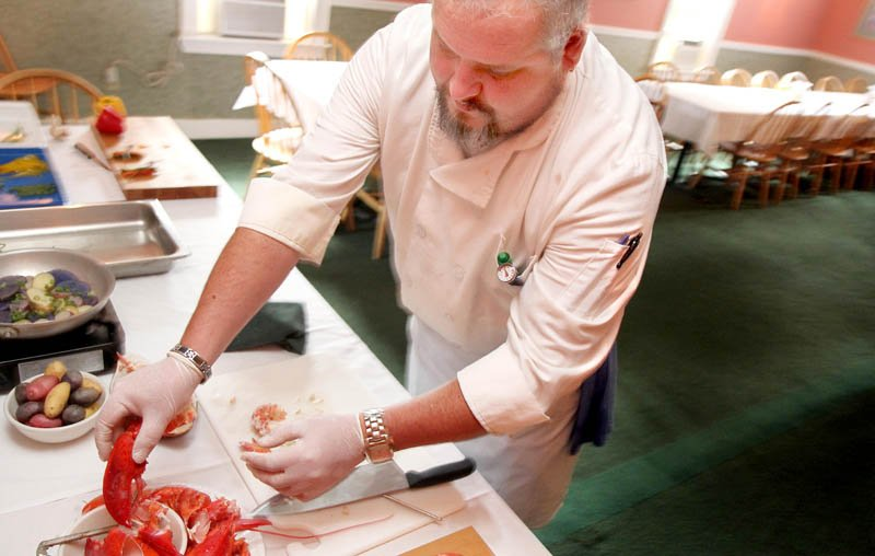 Chef Bob McGowan of The Heritage House in Skowhegan prepares lobster today for a seafood cocktail to be served at the Taste of Greater Waterville on Wednesday.