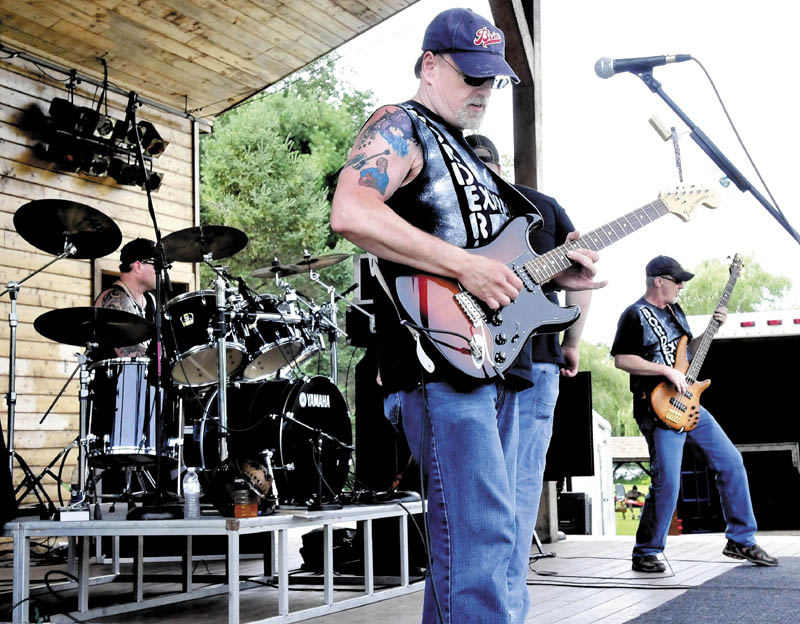 Borderline Express performs during theA Day in the Park for the Arts fundraiser on Sunday, set up to benefit Winslow High School's performing arts programs.