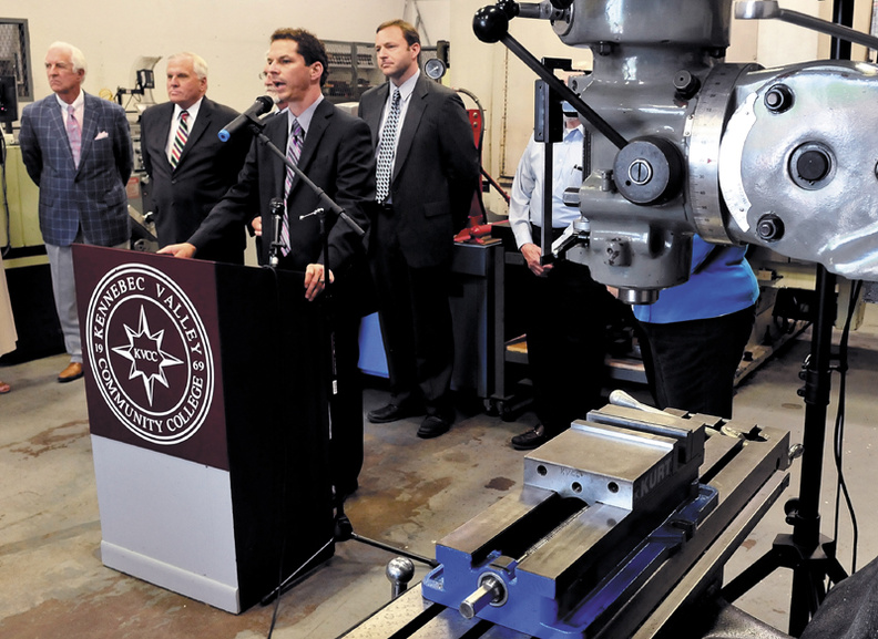 Surrounded by machinist equipment, Maine Senate President Justin Alfond and proponents of a $149.5 million job bond address officials at Kennebec Valley Community College in Fairfield on Wednesday. At left is Dana Connors, president of the Maine Chamber of Commerce, Scott Knapp, president of Central Maine Community College and Speaker of the House Mark Eves.