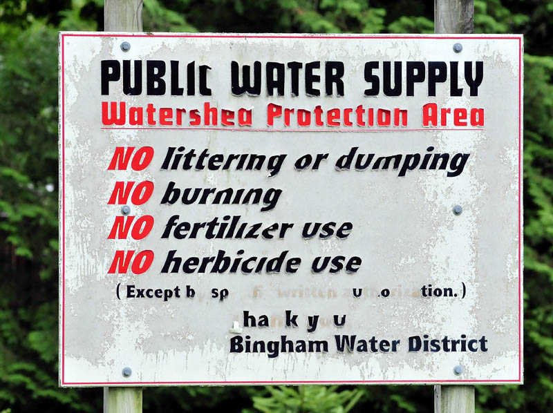 A sign in Bingham limits certain activities that could be detrimental to the town's water supply.