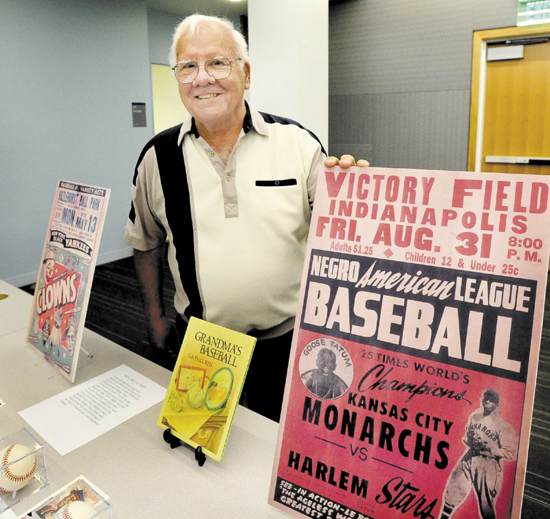 SHARING HIS KNOWLEDGE: Joe Caliro lectures and displays baseball memorabilia of the Negro Leagues at the Portland Public Library. Caliro developed his passion for the Negro Leagues when he was in the military stationed in Biloxi, Miss.